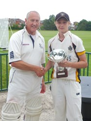 One of the Bolton School cricketers presents the award to the XL Club