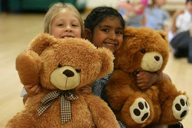 Two girls with their teddy bears