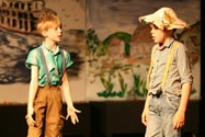 Tom and Huck Finn wonder what to do after witnessing a murder