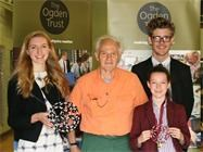 Sir Harry Kroto with two of the Sixth Form helpers and a Junior Girls