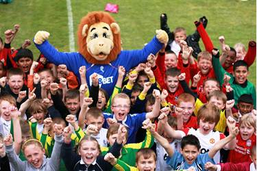 Lofty the Lion welcomes the children
