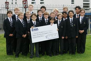 The young entrepreneurs with their cheque for Cancer Research
