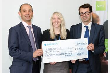 Miss Reynolds receives the cheque at the awards presentation