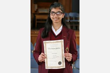 Kiran with her certificate