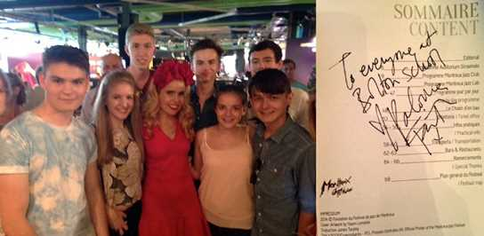 Members of the band meet Paloma Faith (left) and receive her autograph (right)