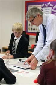 A Park Road pupil tries his hand at pushing a wire down an artery under the guidance of Jon Swan