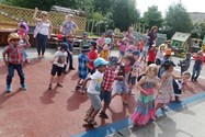 The children learned to dance to country and western music