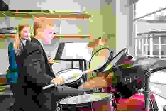 junior boys playing drums