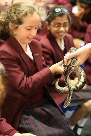 The brave girls got to hold Jimmy the Python