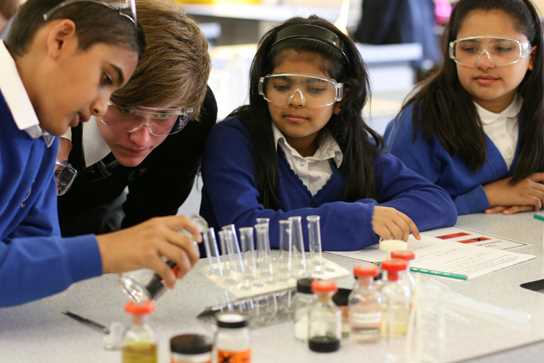 The pupils study chemical reactions