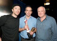 Chris Martin of Coldplay, Producer of the Year Brit Award winner Marcus Dravs and Tony Wadsworth backstage at the Music Producers Guild awards
