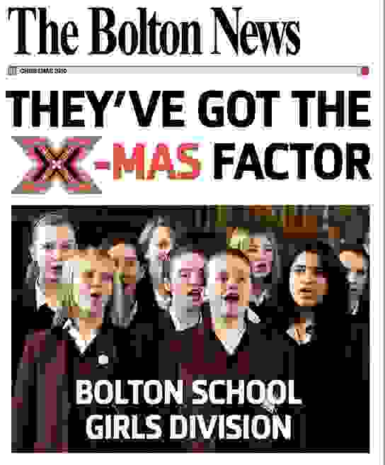 Girls on the front cover of the Bolton News as they win the X-Mas Factor competition to find the best school choir