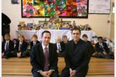 Mr Whittaker and the boys offer a variety of food items to Reverend Cornes of St Lukes Church