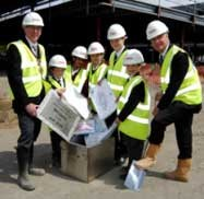 Pupils are joined by the Mayor of Bolton and Williams BMW reps as they bury the time capsule