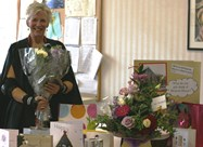 Mrs Gill Richards and leaving flowers and gifts