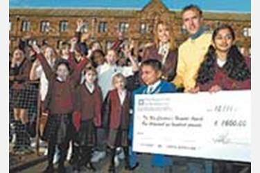 Upon arrival the Nevilles were presented with a cheque for 1600 pounds