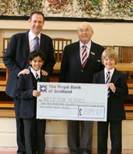 Stephen Whittaker and boys present cheque to Help for Heroes