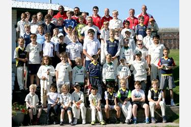 The young cricketers with Darren Maddy and their six coaches