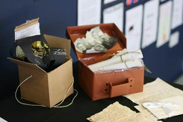The soldier's kit and gas mask are displayed with hand-written letters