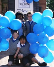 Pupils celebrate moving into their new school