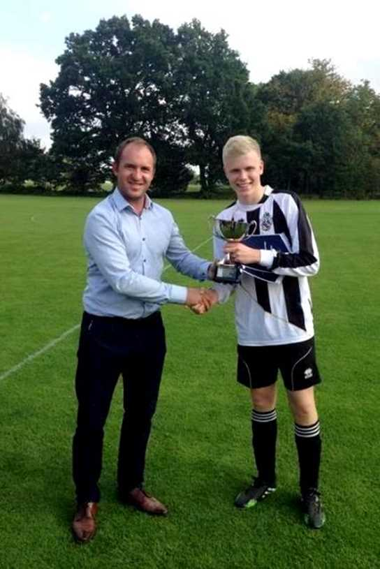 Captain Will Dowie receives the trophy from CSS Sports