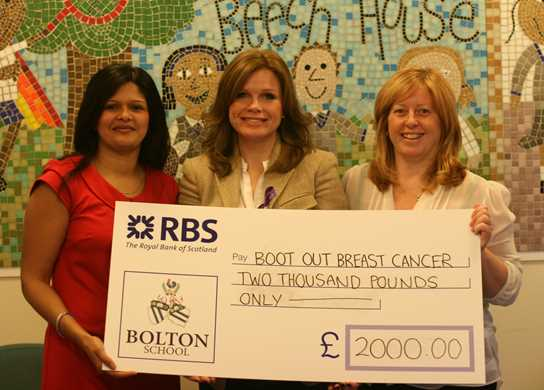 Beech House Parents Association present a cheque to Debbie Dowie founder of the charity Boot Out Breast Cancer
