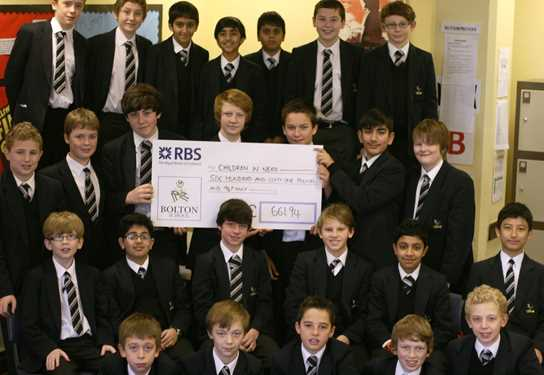 8d with their cheque for Children in Need