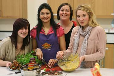 Anjali Pathak prepares onion bhajis at Bolton School