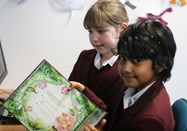 Girls discover Augmented reality books