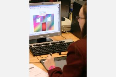 Year 8 girls use graphic tablets to design their own house