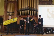 Boys deliver their pitch supporting the selling of Fairtrade bananas at morning break