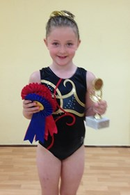 Georgie with her rosettes and trophy