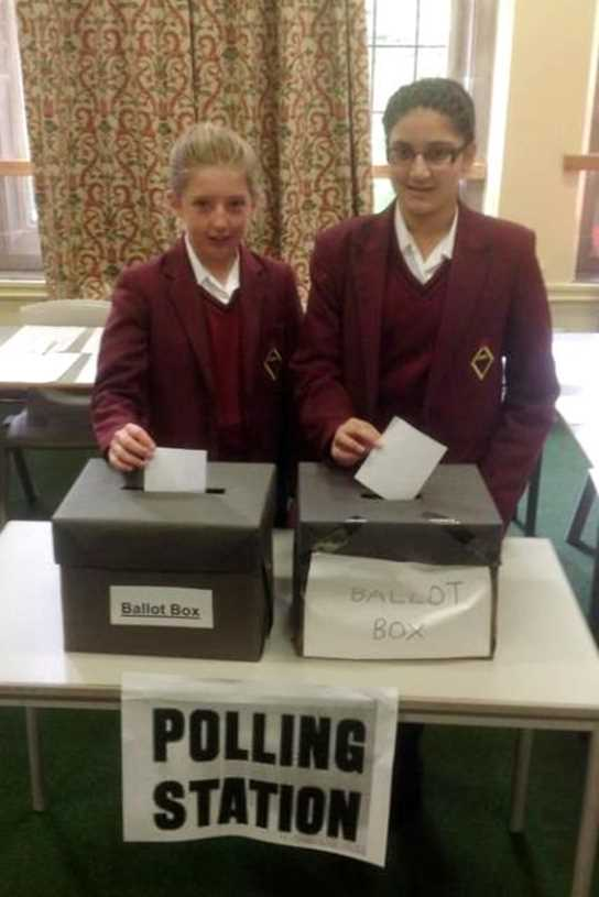 Two girls cast their votes