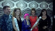 Olivia with Zandra Rhodes and the two runners up in front of Olivia
