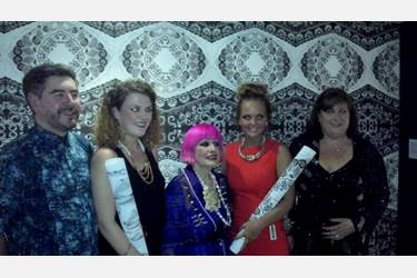 Olivia with Zandra Rhodes and the two runners up in front of Olivia's winning wallpaper design