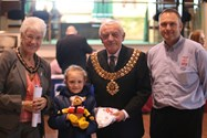 Isabel Brennand, aged 7, receives her prizes for winning the competition to design a poster to advertise the event
