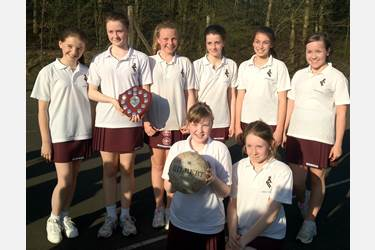 The U12 team celebrate a fine victory in the town netball championships