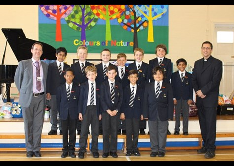 Some of the boys, Headmaster Mr Whittaker and Reverend Cornes with the Harvest gifts