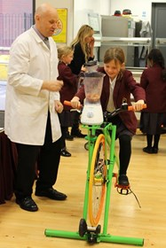 One of the girls makes a smoothie with the pedal-powered blender