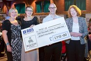 Mrs Natalie James and Headmistress Sue Hincks present the cheque for PMSF UK to Kathryn and Andrew Kay