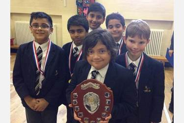 The Junior Boys' Chess Team with their trophy