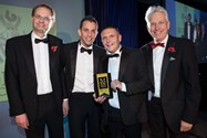 Headmaster Mr Britton and host Nicholas Owen with the MEN Young Business of the Year winners Prymo Surface Solutions