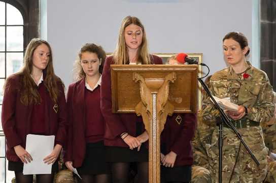 Major Aspin led the prayers, accompanied by four girls