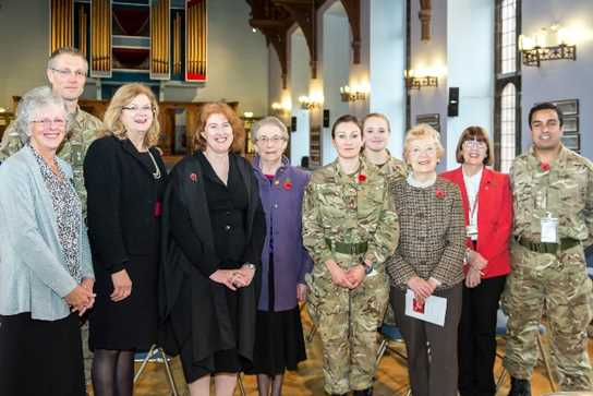 Some of the Old Girls with serving members of the armed forces after the Remembrance Service