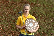 Ellie with the Junior Championship Shield, wearing her Cumbria Ladies County Golf Association uniform