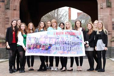 Some of the girls who went on the trip with the banner used to welcome them to SKCV