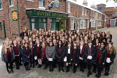 The Girls' Division singers on the cobbles at Coronation Street