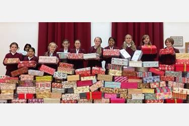 Some of the girls with the huge array of presents donated