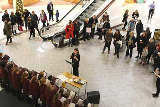 Shoppers stopped to listen to and enjoy the girls' seasonal music