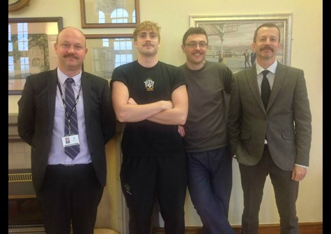 Boys' Division staff boasting their facial adornments grown for the Movember campaign